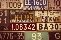 Sepia toned License Plates. Various retro License Plates on the wall Stock Photos