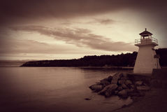 Sepia Toned Lighthouse on Coastline Stock Photography