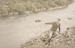Sepia toned portrait of a man on a rocky cliff Royalty Free Stock Photos