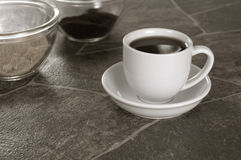 Sepia Toned White Coffee Cup on Granite Counter Royalty Free Stock Photography