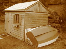 Sepia Toolshed with Boat. Leaning in Maine, usa royalty free stock photos