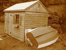 Sepia Toolshed con el barco Fotos de archivo libres de regalías