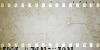 Sepia vintage cracked film strip frame. Grunge design element Royalty Free Stock Image