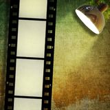 Sepia vintage film strip background and led reflector Stock Photos