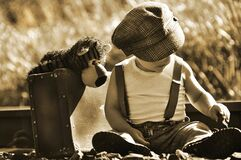 Free Sepia Vintage Little Baby Boy, Suitcase, Teddy Bear On Big Adventure Royalty Free Stock Photography - 184078547