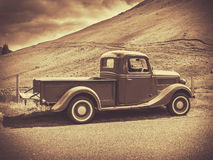 Sepia Vintage Truck. Retro Style Sepia Image Of A Vintage Truck In The Countryside Stock Photo