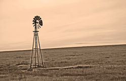 Sepia Windmill on the Windy Plains Royalty Free Stock Photo