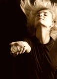 Sepiaabbildung eines Mädchens mit einer Stoppuhr (Fokus auf Uhr) Lizenzfreies Stockbild