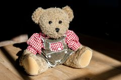 Sepp from  Bavaria, a Teddybear as part of a collection, wearing traditional clothing, like a checkered shirt and leather pants stock photo
