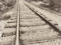 Seppia d'annata del binario ferroviario della ferrovia della ferrovia della gara motociclistica su pista vecchia retro Fotografia Stock