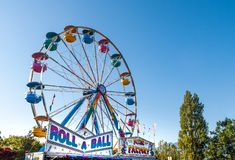 Free Sept. 2, 2012 - Vancouver, Canada: Colourful Fairground Ferris Wheel And Midway At PNE Fair On A Sunny Afternoon. Royalty Free Stock Image - 164013866