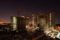 Sept hautes constructions en construction photographie stock