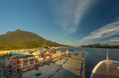 Sept 17, 2018 - Ketchikan, AK: Emptying cruise ship dock and shops on Spruce Mill Way at sunset. Sept 17, 2018 - Ketchikan, AK: Elevated view of emptying dock stock photography