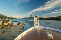 Sept 17, 2018 - Ketchikan, AK: Panorama of Tongass Channel, waterfront and departing cruise ships at sunset. Sept 17, 2018 - Ketchikan, AK: Panorama of Tongass stock photography