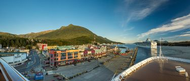 Sept 17, 2018 - Ketchikan, AK: Panorama of Tongass Channel, waterfront and departing cruise ships at sunset. Sept 17, 2018 - Ketchikan, AK: Panorama of Tongass royalty free stock photo