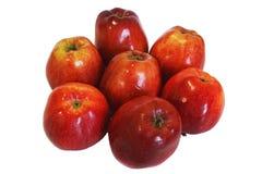 Sept pommes rouges sur un fond blanc Image libre de droits