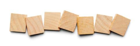 Sept tuiles en bois images stock