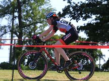 Female rider at the Cycling Race event. September 10, 2017 - Cyclocross extreme cycling on the challenging race terrain Royalty Free Stock Photo