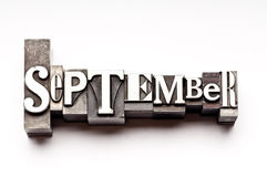 September. The month of September done in letterpress type on a white paper background