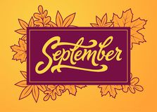 September brush lettering in rectangle frame. Vector typography with autumn leaves. Brush lettering for banner, poster Stock Image