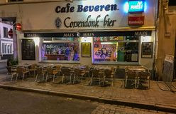Nighttime cafe, Antwerp, Belgium. September 2017: Cafe Beveren at night, Antwerp, Belgium. Tables and chairs set up outside the cafe Stock Photo