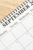 September on calendar. Close up of spiral bound calendar displaying month of September Stock Photos