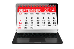 September calendar over laptop screen. 2014 year calendar. September calendar over laptop screen on a white background Royalty Free Stock Photography
