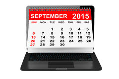 September 2015 calendar over laptop screen. 2015 year calendar. September calendar over laptop screen on a white background Royalty Free Stock Photo
