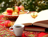 September Coffee. A cup of coffee with books and apples Stock Images