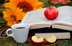 Coffee. A cup of coffee with books and apples Stock Images