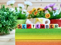 September. Colorful cube letters on sticky note block. royalty free stock photo