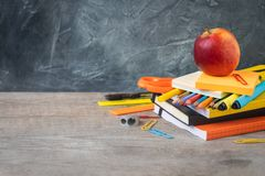 1 September concept postcard, back to school or college, an apple on supplies royalty free stock photography