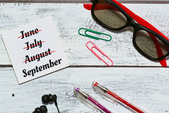 September countdown concept. Countdown to autumn concept in loft interior saunglasses, earphones, office accessories, reminder - flat lay, top view Royalty Free Stock Photos