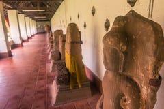 26 september, 2014: De standbeelden van Boedha in Dat Luang, Vientiane, Laos Stock Foto's