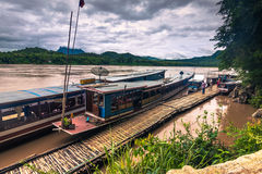 September 21, 2014: Docks at the entrance to the Pak Ou caves, L Royalty Free Stock Images
