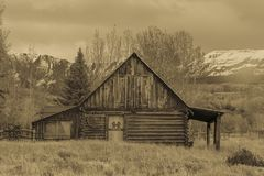 Double R Log Cabin barn on Hastings Mesa, Colorado near Ridgway. SEPTEMBER 28, 2017 - Double R Log Cabin barn on Hastings Mesa, Colorado near Ridgway stock photography