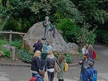 September 19, 2015, Dublin, Ireland. Visitors Taking In The Oscar Wilde Statue Located In Dublin, Ireland. This was taken on a tour around Dublin, Ireland royalty free stock photo