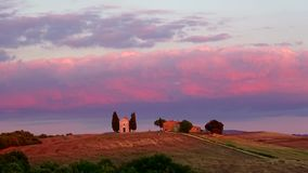 September evening at the chapel of the Madonna di Vitaleta. Italy timelapse. September evening at the chapel of the Madonna di Vitaleta, Italy timelapse stock video footage