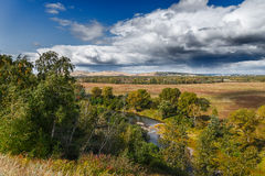 September. The first autumn days creates an interesting combination of yellow, green, red. Khakassia. One of the flow capacity of the Yenisey River Royalty Free Stock Photography
