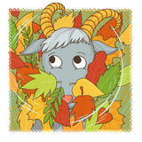 September goat. Smiling goat in the fallen leaves Stock Images