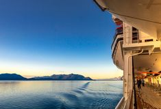 September 14, 2018 - Inside Passage, AK: Cruise passengers exercising at sunrise stock photos