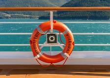 September 14, 2018 - Inside Passage, Alaska: Orange lifering on cruise ship. stock photo
