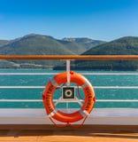 September 14, 2018 - Inside Passage, Alaska: Orange lifering on cruise ship. royalty free stock photo