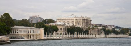 Dolmabahce Palace in from the water stock photography