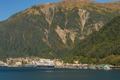 September 14, 2018 - Juneau, Alaska: Cruise ship The Zaadam docked in port. September 14, 2018 - Juneau, Alaska: Docks and wharf at entrance to city harbor with royalty free stock photography