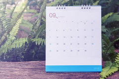 September-Kalender 2016 auf hölzerner Tabelle, Weinlesefilter Lizenzfreie Stockfotos