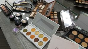 September 20, 2019 - Kamenskoye, Ukraine: a set of various makeup cosmetics palettes on a table in beauty studio. Eye. September 20, 2019 - Kamenskoye, Ukraine stock video footage