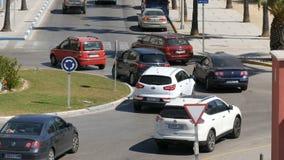September 26 - 2017, La Linea, Spain: Many cars on a roundabout turn on the road. September 26 - 2017, La Linea, Spain: Many cars on the roundabout turn on the stock video footage