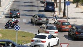 September 26 - 2017, La Linea, Spain: Many cars on a roundabout turn on the road. September 26 - 2017, La Linea, Spain: Many cars on the roundabout turn on the stock video