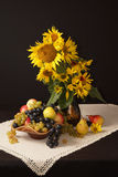 September lifestyle. Autumn still life with sunflowers, flowers, grapes, pears, apples stock image